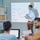 Group of young modern people in smart casual wear analyzing data on projection screen in the office - PhotoDune Item for Sale