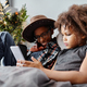 African American Kids Using Smartphone on Bed - PhotoDune Item for Sale