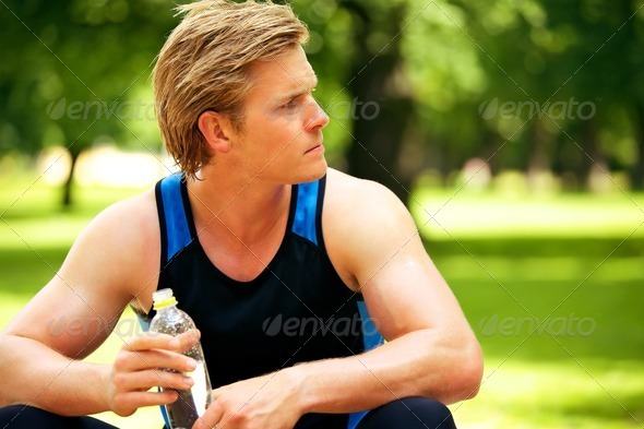 Athlete Holding a Water Bottle - Stock Photo - Images