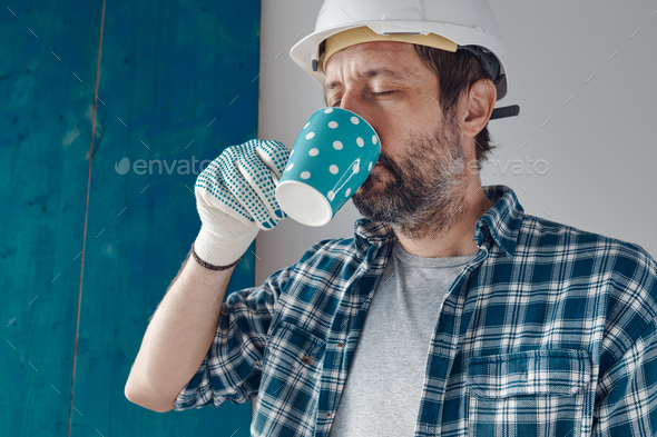 Construction engineer on a morning coffee break - Stock Photo - Images