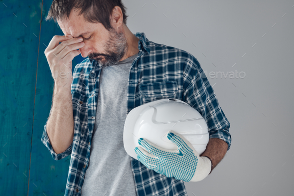 Tired and worried construction industry engineer - Stock Photo - Images