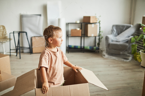 Kid Playing in Box - Stock Photo - Images