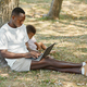 African American Father Working in Park with Son - PhotoDune Item for Sale