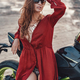 Seductive woman relaxing on beach with black motorbike - PhotoDune Item for Sale