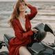 Beauty biker sitting on black motorcycle against sea - PhotoDune Item for Sale