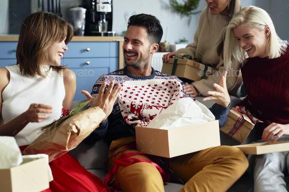 Man receiving another ugly jumper - Stock Photo - Images