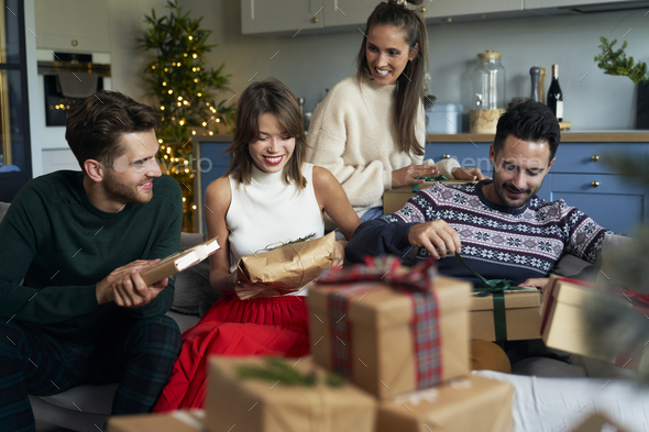 Friends and boxes with Christmas presents - Stock Photo - Images