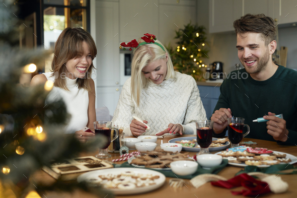 Best friends around Christmas table - Stock Photo - Images