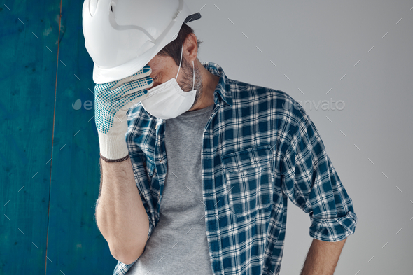 Worried construction engineer with protective face mask - Stock Photo - Images