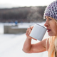 Senior woman in sports clothes drinking tea outdoors in winter, cold therapy concept. Copy space. - PhotoDune Item for Sale