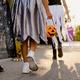 White children walking down street during trick-or-treating - PhotoDune Item for Sale