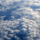 Clouds and sky as seen through window of an aircraft - PhotoDune Item for Sale