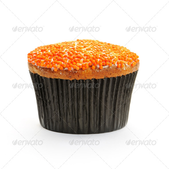 Cupcake with orange icing - Stock Photo - Images