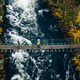 Aerial view of fall forest and blue river with bridge in Finland. - PhotoDune Item for Sale
