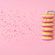 Creative banner with empty space.Painted donut roller on a pink background. Top view. - PhotoDune Item for Sale