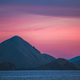 Sunset over the mountains and ocean. Indonesia - PhotoDune Item for Sale
