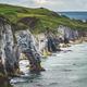 Close-up green covered rocks. Irish shoreline - PhotoDune Item for Sale