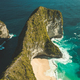 Green covered cliff. Blue ocean. Indonesia - PhotoDune Item for Sale