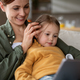 Mother with daughter watching kids programme on tablet indoors at home, single parenting concept. - PhotoDune Item for Sale