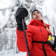 Mountain rescue service woman on operation in winter in forest, finding person after avalanche. - PhotoDune Item for Sale