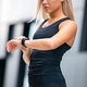 Woman Runner Checking Heart Rate Using Smartwatch After Workout - PhotoDune Item for Sale