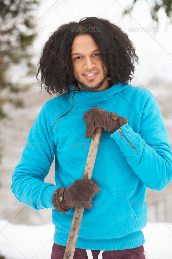 Young Man Clearing Snow From Drive - Stock Photo - Images