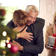 Couple Greeting Senior Parents As They Arrive With Presents To Celebrate Christmas - PhotoDune Item for Sale