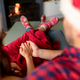 Back view of caucasian couple wearing santa hats and christmas socks at christmas time - PhotoDune Item for Sale