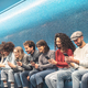 Happy friends using mobile smartphone in underground station - PhotoDune Item for Sale