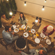 Family and friends celebrating at dinner on a rooftop terrace - PhotoDune Item for Sale