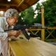 Grandma with gun poses in shooting gallery - PhotoDune Item for Sale