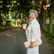 Funny granny drinks coffee in summer park - PhotoDune Item for Sale