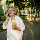 Pretty granny using mobile phone in summer park - PhotoDune Item for Sale