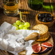 Camembert Cheese Serwed with Fruits and Wine on Wooden Table - PhotoDune Item for Sale