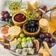 Cheese Board Various Cheese Olives,Figs Fruits, Grapes, Wine and Nuts - PhotoDune Item for Sale