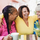Multiracial senior friends meet and chat at bar outdoor while drinking coffee together at bar - PhotoDune Item for Sale