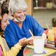 Happy multiracial senior woman using mobile phone at bar during coronavirus outbreak - PhotoDune Item for Sale