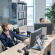 Young businessman speaking on the phone by workplace - PhotoDune Item for Sale