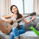 Asian woman playing music by guitar at home, young female guitarist musician lifestyle - PhotoDune Item for Sale