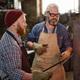 Blacksmith forging iron in the workshop - PhotoDune Item for Sale
