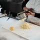 Woman using potato press for fresh hand made gnocchi inside pasta factory - PhotoDune Item for Sale
