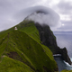 Kalsoy island and Kallur lighthouse at cloudy day. Faroe Islands - PhotoDune Item for Sale