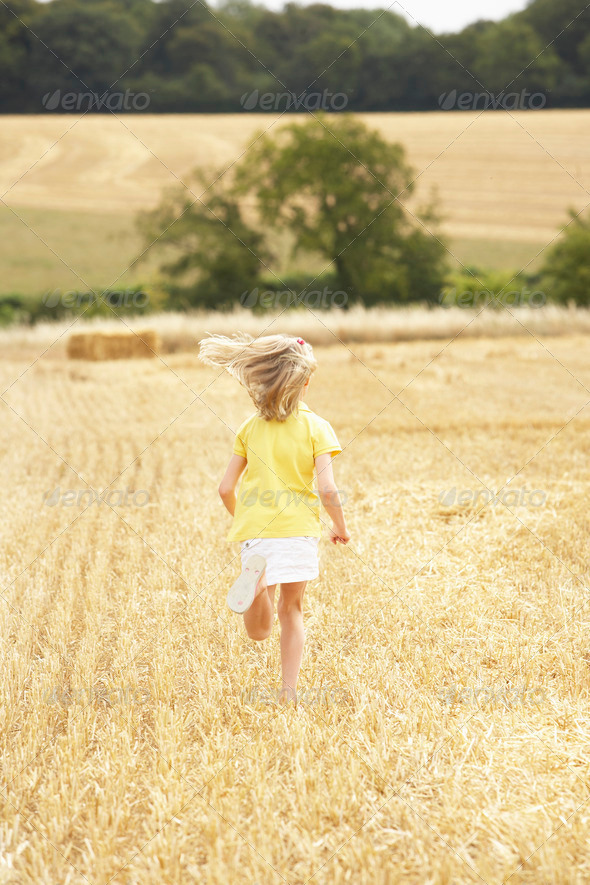 Girl Running Through Summer Harvested Field - Stock Photo - Images