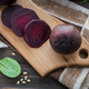 Boiled beetroot, baby spinach leaves and pine nuts on wooden cutting board. - PhotoDune Item for Sale