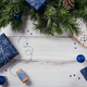 Gifts, fir tree branches, blue decorations on wooden background - PhotoDune Item for Sale