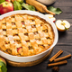 Apple pie with ginger and cinnamon at dark wooden table - PhotoDune Item for Sale