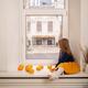 Lovely little girl sitting on the window - PhotoDune Item for Sale