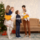 Portrait of friendly family on Christmas Eve - PhotoDune Item for Sale