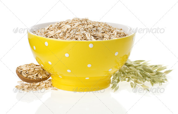 oat flake in bowl and ears on white - Stock Photo - Images