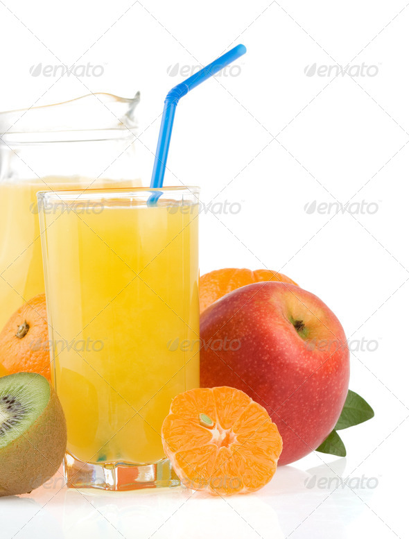 fresh tropical fruits and juice in glass - Stock Photo - Images